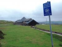 Halfway station on the Great Orme Tramway was completely rebuilt in 2001. This winter view (with haulage cables removed) from the nearby level crossing shows the lower station and tram shed on the upper section, with the exhibition hall, winding house and station of the lower section behind. The maximum gradient on the upper level is a moderate 1:10 but on the lower street running stretch it can be as steep as 1:3.8. <br><br>[Mark Bartlett&nbsp;30/11/2011]