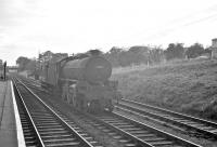 Platform view south along the Waverley route from St Boswells on 10 September 1962. St Margarets B1 no 61244 <I>Strang Steel</I> is about to run through the station heading north with a brake van.<br><br>[R Sillitto/A Renfrew Collection (Courtesy Bruce McCartney)&nbsp;10/09/1962]