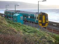 158823 picks up two passengers at Llanaber Halt, north of Barmouth, on 7 December 2011. The train will depart as the 13.55 service forward to Pwllheli (10.09 ex-Birmingham International).<br><br>[David Pesterfield&nbsp;07/12/2011]