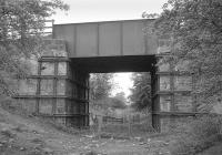 The B981 road bridge spanning the trackbed of the former branch running to Glencraig Colliery, Fife (closed 1966), which left the Bowhill line just beyond Bowhill Junction to the west of Cardenden. Photographed looking west in  May 1991.<br><br>[Bill Roberton&nbsp;17/05/1991]