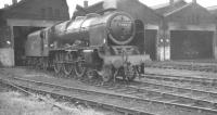 Royal Scot 4-6-0 no 46106 <I>'Gordon Highlander'</I>, fitted with straight BR smoke deflectors, stands in front of Millhouses shed, Sheffield, in May 1961.<br><br>[K A Gray&nbsp;27/05/1961]