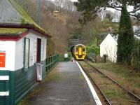 158820 leaves Penhelig after picking up a passenger and heads towards the east side tunnel on the 13.26 service to Machynlleth. For a small halt there is a substantial wooden waiting room on the platform. <br><br>[David Pesterfield&nbsp;06/12/2011]