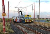 The Blackpool and Fleetwood Tramway closed again after the 2011 illuminations for the final upgrade to the system ahead of the Easter 2012 reopening. During 2011 trams had been limited to the Pleasure Beach to Little Bispham stretch and modified <I>Centenary</I> tram 647 is seen here leaving the turning circle at the northern limit of operations just before the winter closure. The rusty track in the foreground is for Cleveleys and Fleetwood (curving right beyond the tram). 647 was withdrawn from service at the end of the season just over a week later.<br><br>[Mark Bartlett&nbsp;26/10/2011]