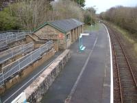 View east over Penychain Station in December 2011, showing the extensive ramped access and the large barn type waiting room. This station is adjacent to the Haven Holidays (formerly Butlins) holiday camp and in its heyday would have catered for hundreds of families arriving and departing on summer Saturdays.<br><br>[David Pesterfield&nbsp;08/12/2011]