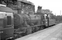 With less than two years to go before the last scheduled passenger train over the through route, a departure for Berwick via Kelso waits in the bay at the south end of St Boswells station on 10 September 1962. Locomotive in charge is Hawick's standard class 2 2-6-0 no 78049.<br><br>[R Sillitto/A Renfrew Collection (Courtesy Bruce McCartney)&nbsp;10/09/1962]