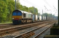 An Anglo-Scottish Intermodal service heads north through Euxton on 29 April 2011 with DRS 66418 in charge.<br><br>[John McIntyre&nbsp;29/04/2011]