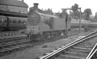 Drummond 0-4-4T no 30040 and minder take five alongside Bournemouth shed in August 1960.<br><br>[K A Gray&nbsp;09/08/1960]