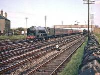 A2 Pacific no 60507 <I>'Highland Chieftain'</I> runs through Saughton Junction on 11 August 1957 and is about to turn north on the route towards the Forth Bridge. The train has just passed a freight standing at signals on the right beyond the footbridge.<br><br>[A Snapper (Courtesy Bruce McCartney)&nbsp;11/08/1957]