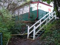 For a small halt there is a substantial wooden waiting room on the platform. The waiting shelter is mounted on built up foundations and wooden steps alongside give access to platform level. There is also a flight of steps from the road, so definitely not a step free access station.<br><br>[David Pesterfield&nbsp;06/12/2011]