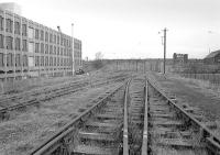 Part of the disused sidings at the former Gorgie Cattle Market looking east towards Gorgie Junction in 1975. The track was later donated by Edinburgh City Council to the Strathspey Railway.<br><br>[Bill Roberton&nbsp;//1975]