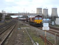 DBS 66041 running round its coal train alongside Didcot power station on 5 January following arrival from Avonmouth.<br><br>[Peter Todd 05/01/2011]