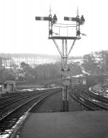 Looking towards the junction with the Largs branch from the end of the platform at Fairlie Pier on 25 February 1963. Following closure, the ex-GSWR lower quadrant signals became a permanent exhibit at the Glasgow Museum of Transport [see image 30248]. <br><br>[R Sillitto/A Renfrew Collection (Courtesy Bruce McCartney)&nbsp;25/02/1963]
