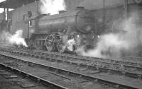 K3 2-6-0 no 61968 stands alongside the coaling stage at Heaton shed on a chilly February day in 1961. 61968 spent most of its life at St Margarets, from where it was eventually withdrawn 8 months after the photograph was taken.<br><br>[K A Gray&nbsp;04/02/1961]