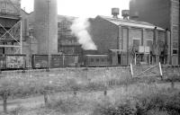 In 1971, the British Aluminium Company's Burntisland works obtained two Fowler 0-4-0DMs from United Fireclay Products, Bathville, West Lothian, to replace their steam pugs. One of them was photographed from a passing train in 1973. The works has since been demolished, with housing now covering most of the site.<br><br>[Bill Roberton&nbsp;//1973]
