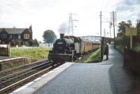 During 1957/58 no 40186 spent around 9 months at St Margarets on what appears to have been an extended loan from Dawsholm shed. The ex-LMS 2-6-2T is seen here approaching Joppa station on 23 August 1957 heading west, with our local commuter still observing events from behind the fence [see image 37154]. I wonder if he ever made it to work on that particular Friday....<br><br>[A Snapper (Courtesy Bruce McCartney)&nbsp;23/08/1957]