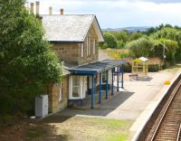 The attractive 1864 station at Fearn, seen from the B9165 road bridge in the summer of 2007. Looking south west along the platform in the general direction of Invergordon.<br><br>[John Furnevel&nbsp;30/08/2007]