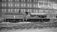 Wainright ex-SECR 'D' class 4-4-0 no 31737 of 1901 stands in the sidings alongside Stewarts Lane shed in the 1950s. The locomotive was subsequently preserved and restored and is now on display at the NRM in York... via Tweedmouth [see image 32893]. <br><br>[K A Gray&nbsp;//]
