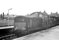 Clayton D8502 with a freight at Kilwinning in May 1963. The locomotive had been delivered new to Polmadie in October 1962 and was withdrawn from the same location exactly 9 years later. D8502 was cut up at St Rollox in March 1973.<br><br>[R Sillitto/A Renfrew Collection (Courtesy Bruce McCartney)&nbsp;25/05/1963]