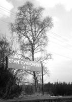 A fine surviving platform sign at Grantown-on-Spey West in April 1968, three years after complete closure.<br><br>[David Spaven&nbsp;/04/1968]