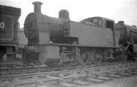 Fowler 2F 0-6-0T no 47162 (minus some key components), photographed in the 'stored' sidings at Bathgate in April 1959. The locomotive is recorded as being officially withdrawn from Dalry Road shed, where it had spent its entire post-nationalisation life, some 8 months later at the end of that year.<br><br>[Robin Barbour Collection (Courtesy Bruce McCartney)&nbsp;21/04/1959]