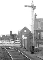 Looking north over the A955 level crossing to the north of Kirkcaldy in 1974 along the branch from Frances Colliery to Dysart exchange sidings. Not a weed in sight! [See image 20372]<br><br>[Bill Roberton&nbsp;//1974]