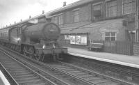 Class J39 0-6-0 no 64806 runs east on the North Tyneside electrified line through Walkergate station, between Heaton and Wallsend with empty stock in the early sixties. The building behind the station is Walkergate carriage works.<br><br>[K A Gray&nbsp;//]