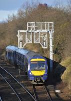 170 470 heads for Haymarket out of Dalmeny up loop where it had reversed after arriving as the 12.44 class 5 (empty stock) working from Linlithgow, on 22 January 2012. The top of the Forth Bridge can be seen above the trees.<br><br>[Bill Roberton&nbsp;22/01/2012]
