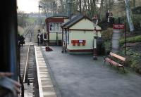 Tiny Damens station, as seen from a passing train (it is a request stop) showing the KWVR passing loop ahead beyond the level crossing. The platform is only the length of one coach but like all KWVR stations Damens is maintained in exceptional period condition. <br><br>[Mark Bartlett&nbsp;07/01/2012]