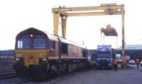 Scene at Elgin freight depot on 2nd April 2002 during a woodchip-by-rail demonstrator project managed by the photographer for Scottish Enterprise. Unfortunately, the crane failed at the vital moment, and the laden container had to be sent by road to Mossend...<br><br>[David Spaven&nbsp;02/04/2002]