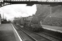 Ardrossan shed's Black 5 no 45463 emerges in style from the south portal of Fairlie tunnel and runs through the station on 24 November 1962 at the head of a Glasgow bound boat train.<br><br>[R Sillitto/A Renfrew Collection (Courtesy Bruce McCartney)&nbsp;24/11/1962]