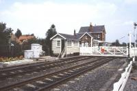 View towards Poppleton station from the west side of the level crossing in July 1989, looking towards York.<br><br>[Ian Dinmore&nbsp;/07/1989]