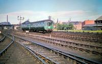 A 2-car DMU, bound for Corstorphine, is about to run west past Haymaket MPD on 4 July 1959. The roof of Haymarket Central Junction signal box can be seen above the second vehicle of the train. <br><br>[A Snapper (Courtesy Bruce McCartney)&nbsp;04/07/1959]