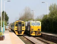 A Northern 158 pulls away from Hunmanby station on 21 April 2009 with the late running 0941 Sheffield - Scarborough service, just as a Network Rail weedkilling train arrives on the up line.<br><br>[John Furnevel&nbsp;21/04/2009]