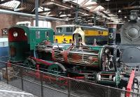 Although the railway locomotives in the Power Hall at Manchester Museum of Science and Industry are all static exhibits there are numerous working stationary steam engines and so the smell of steam and hot oil gives the building a special atmosphere. Isle of Man Railway 2-4-0T No. 3 <I>Pender</I> was constructed by Beyer Peacock in 1873 at Gorton and is now a sectioned exhibit with other Manchester built locomotives behind. <br><br>[Mark Bartlett&nbsp;30/12/2011]