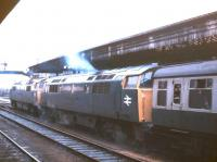 A pair of Class 52 <I>'Western'</I> diesel-hydraulic locomotives double heading a train at Exeter St Davids in 1977.<br><br>[Ian Dinmore&nbsp;//1977]