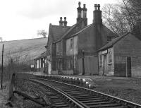 Lambley station on the Alston branch in March 1976, displaying both a corporate image BR running-in board at the far end and a North Eastern Region painted board (doubtless with a tangerine background) above the door of the somewhat decrepit shed on the right.<br><br>[Bill Jamieson&nbsp;27/03/1976]