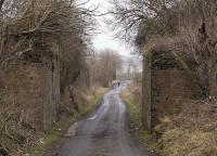 Abutments of the railway bridge over Colquhally Road which carried the Lochgelly Iron & Coal Company's line to the Nellie Colliery. The ironworks closed around 1895 while the pit lasted another seventy years.<br><br>[Bill Roberton&nbsp;31/01/2012]