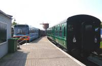 The preserved and rebuilt station at Downpatrick on what is now the heritage <I>'Downpatrick and County Down Railway'</I>, looking from the buffer stops on 24 May 2008. To the left is former NIR railbus RB 003, ex-LEV3, ex-DB977020, the third of BR's prototypes which, regauged to 5'3' worked the Coleraine / Portrush line for about 10 years from 1982. The signals were relocated from Bangor [see image 24989].<br><br>[Colin Miller&nbsp;24/05/2008]