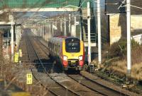 A southbound Virgin Voyager passes Hest Bank level crossing heading for the Lancaster stop on 28 January 2012.<br><br>[John McIntyre&nbsp;28/01/2012]