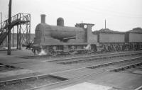 Ex-L&Y Class 27 0-6-0 no 52270, of 1894 vintage, stands in the shed yard at Longsight MPD, Manchester, on 27 September 1958.<br><br>[Robin Barbour Collection (Courtesy Bruce McCartney)&nbsp;27/09/1958]
