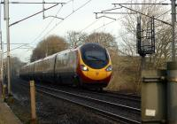A southbound Pendolino rushes towards Carnforth past Yealand Steps on 28 January 2012.<br><br>[John McIntyre&nbsp;28/01/2012]