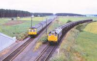 Scene at Alves Junction, photographed from the A96 road bridge on 3 August 1979. 25234 is held with a freight off the Hopeman branch as a passing Inverness - Aberdeen DMU runs through the junction.<br><br>[Peter Todd&nbsp;03/08/1979]