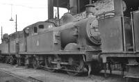 Miscellaneous steam locomotives at the end of their operational lives awaiting disposal at Longsight shed, Manchester, in 1959. Main subject is 0-4-4T no 41908, officially withdrawn from here in November 1959, with 0-6-0T no 47291 nearest the camera, withdrawn the following month. [With thanks to Messrs Rafferty, McRae and Smith]<br><br>[K A Gray&nbsp;//1959]