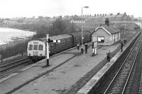 An afternoon Alston branch DMU, with class 101 power car No. E51437 leading, awaits a connecting service off the Carlisle - Newcastle line before setting out from Haltwhistle in March 1976. <br><br>[Bill Jamieson&nbsp;27/03/1976]