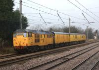 A Network Rail test train propelled by 31602  <I>Driver Dave Green</I> heads north on the Down Slow line at Euxton on 6 February 2012. The train was braking for a signal check due to Preston PSB slotting in a down Northern service off the Chorley line across in front of it at Euxton Junction.<br><br>[John McIntyre&nbsp;06/02/2012]