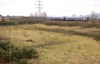 A Fife outer circle 158 service draws away from Lochgelly Station on 31 January 2012. In the foreground is the partially redeveloped site of the goods yard and rail-served gasworks.<br><br>[Bill Roberton&nbsp;31/01/2012]
