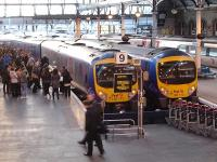 Consecutively numbered TransPennine Express DMU's 185111 & 185112 stand in adjacent bays 9 & 10 at Newcastle Central station on 8 February with a large number of passengers awaiting access to the 16.15 service to Manchester Airport.<br><br>[David Pesterfield&nbsp;08/02/2012]