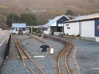 Track layout at the Fairbourne Railway main station site looking towards the buffer stops from alongside Beach Road. The Network Rail level crossing is just visible in the left background beyond the far building. [See image 31267] <br><br>[David Pesterfield&nbsp;07/12/2011]