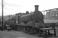 J36 0-6-0 no 65234 survives as a stationary boiler at St Margarets shed in the summer of 1966. The 0-6-0 was officially withdrawn by BR in April 1967 and was eventually cut up at Motherwell Machinery and Scrap, Wishaw, in August that year. [See image 23124]<br><br>[David Spaven&nbsp;//1966]