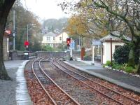 View along Minffordd Ffestiniog Railway station looking towards Porthmadog. The National Rail totem is just visible in the left background, marking the entrance ramp to the subway under the FR tracks, whichs gives access to the low level Arriva Trains Wales platform.<br><br>[David Pesterfield&nbsp;08/12/2011]